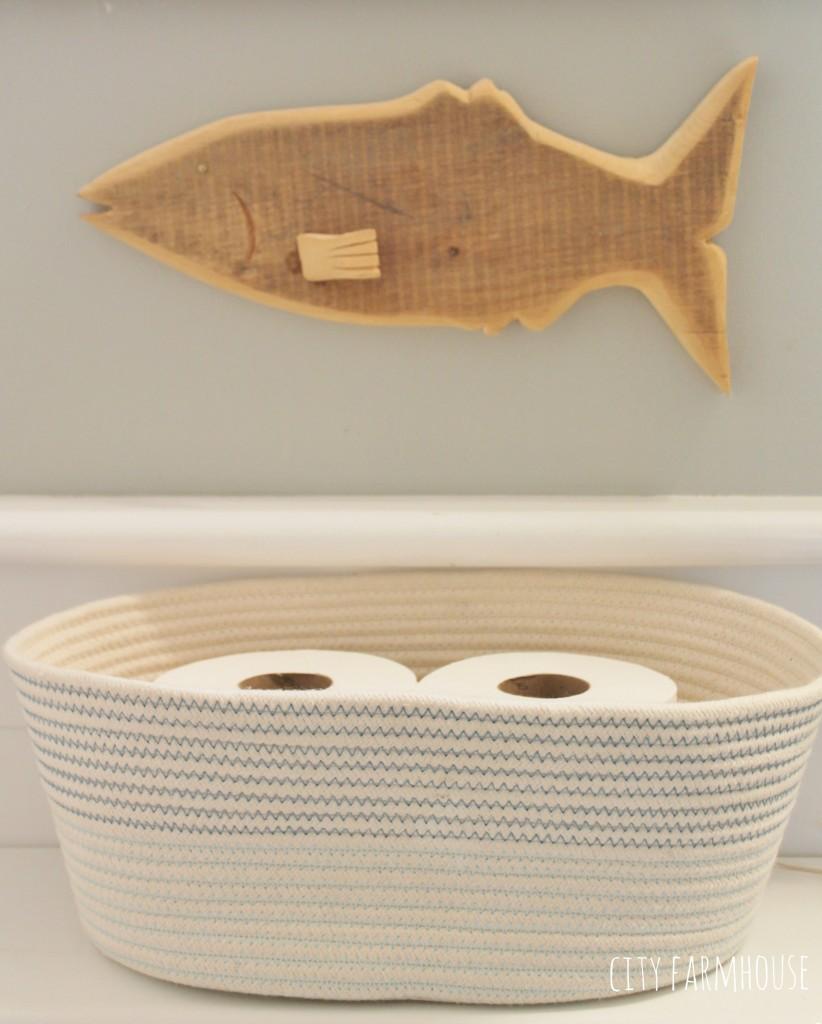 Preppy Coastal Bathroom Makeover-basket Target & carved fish from recliamed wood
