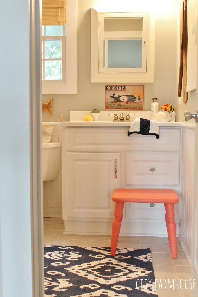 Preppy Coastal Bathroom Makeover-touches of Coral & Navy mixed with fun prints