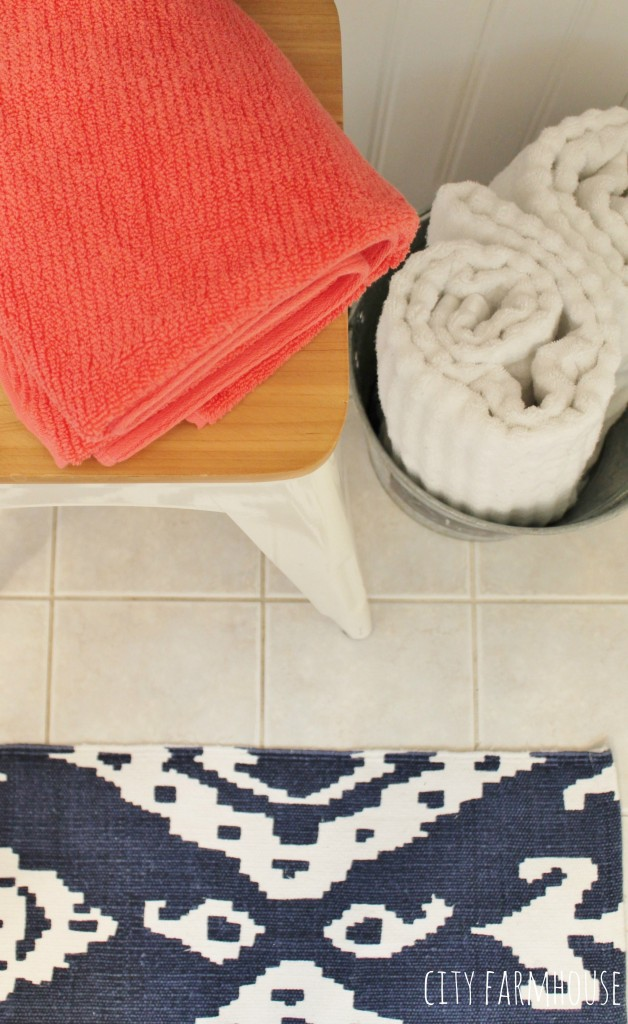 Preppy Coastal Bathroom Makeover_ Navy Ikat Rug & Touches of Coral