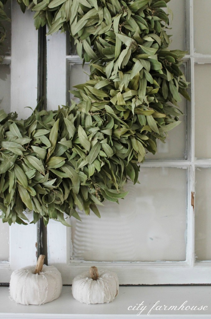 Dried bay leaf wreath from William Sonoma above mantle