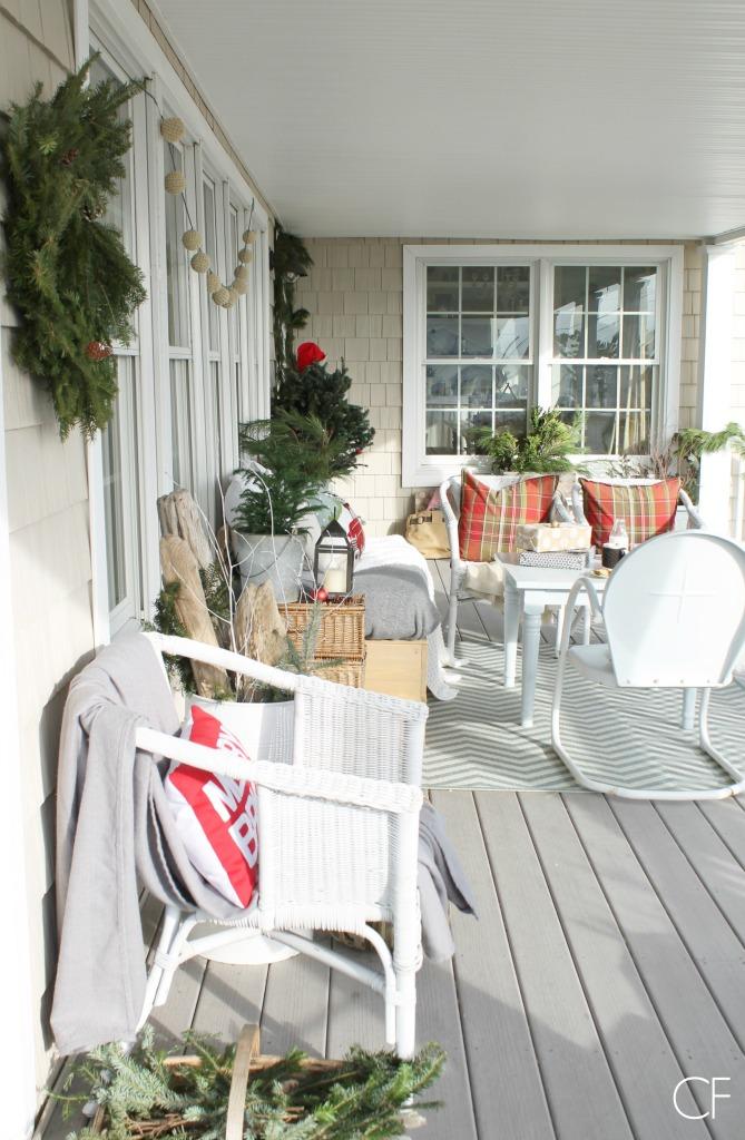 reds & plaids make this cozy Christmas front porch