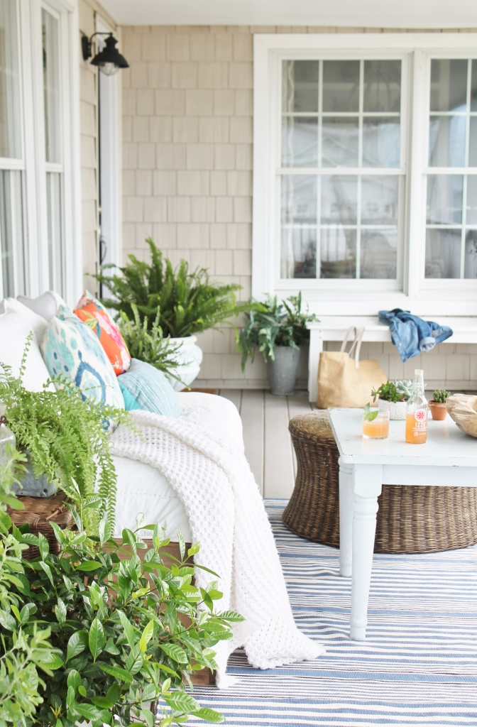 Front Porch Makeover, Dash & Albert Striped Rug and Rattan Ottoman