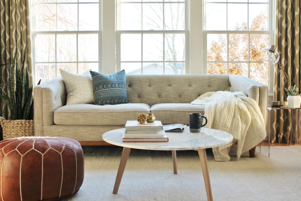City Farmhouse Den Reveal Pre Paint-Neutral Sofa With Pops of Blue