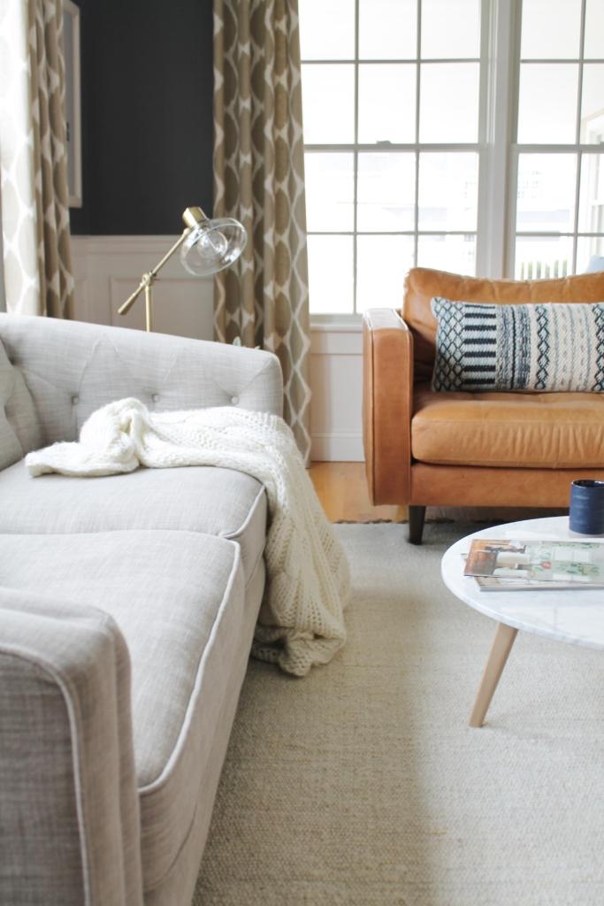 City Farmhouse Den Reveal Pre Paint-Side View Of Modern Arm On Linen Sofa