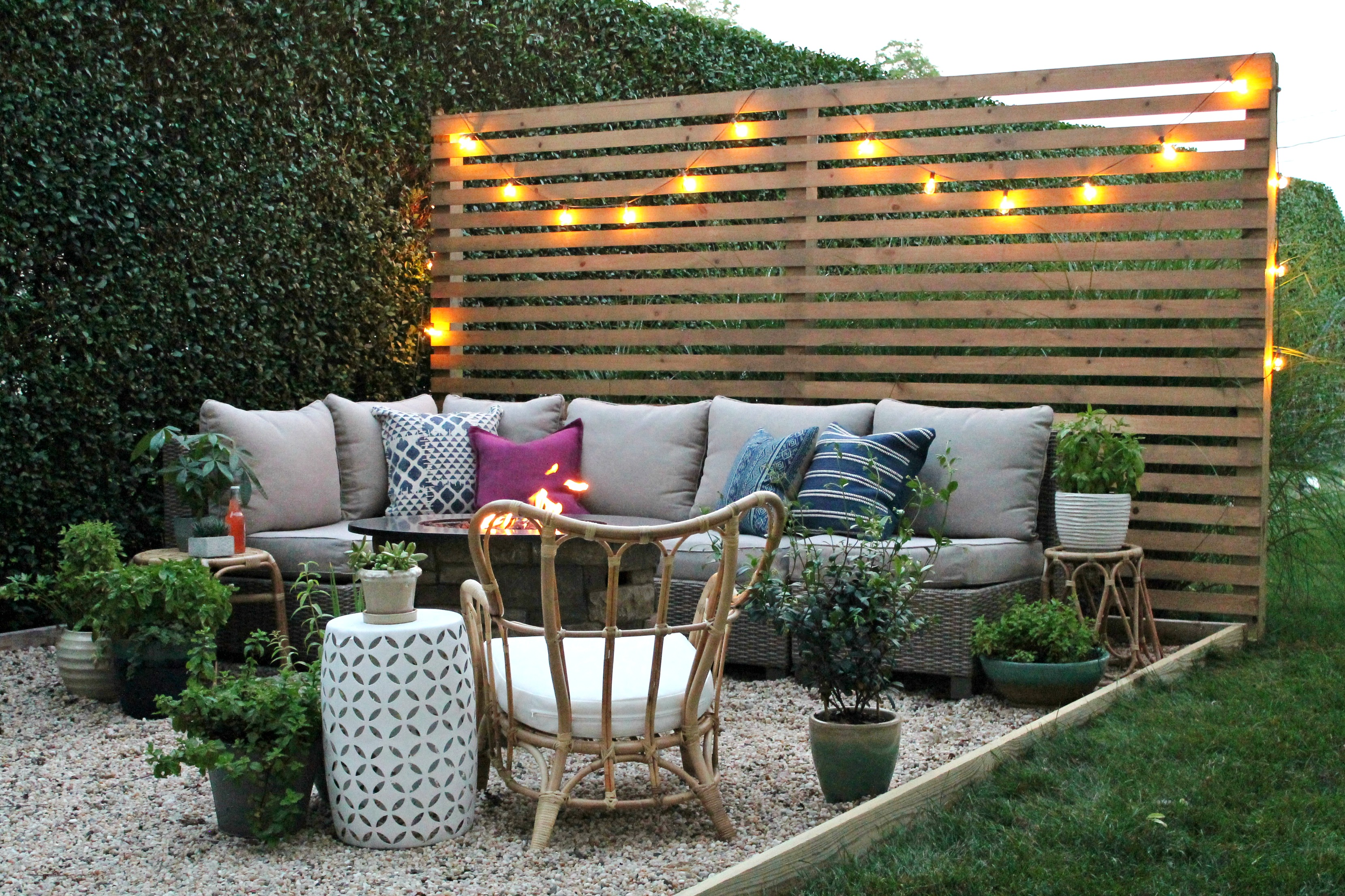 Outdoor Patio With Sectional Fire Pit And Privacy Screen